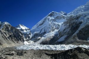 Mount Everest base camp south 5360 meters is the highest point of Everest base camp trek and the beginning of Everest expedition summit from Nepal. Determine how long does it take to get to the Everest base camp? Everest base camp height & temperature during EBC journey, Himalayas, Nepal, in Asia.