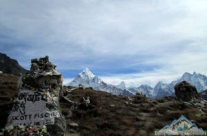 Travelers taking selfie with Scott Fischer memorial chhorten in Everest
